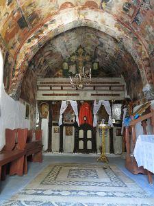 The hochlakos floor and frescoed walls of Panagia Panaiidi