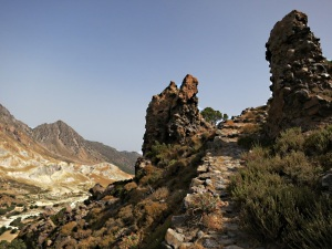Pillars of volcanic conglomerate or 'Breccia' guarding the kalderimi