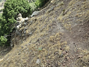 Narrow trail across steeply inclined loose volcanic shale