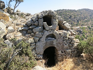 Ancient lava-built church on the shoulder before Emborios
