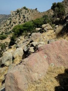 Clambering over small boulders across the path, the lava 'neck' of Parleta in the background
