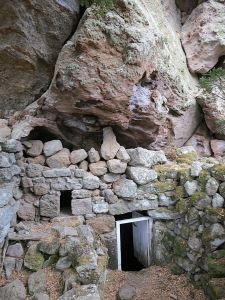The entrance to the subterranean church further along the caldera