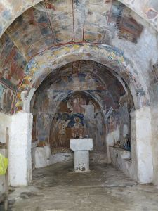 The Siones chapel, walls and ceiling covered in fresco. Further damage to the frescoes has been prevented by repair to the arched roof.