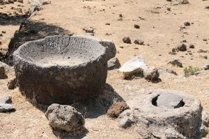 The large bowl of black volcanic rock, the top of the cistern alongside and a prized shard of marble bowl.