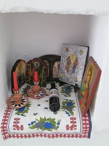 ... and a niche with artefacts, including a half-bottle of wine