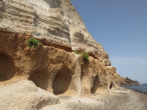 Continuing along the beach, shallow caves just above sea level